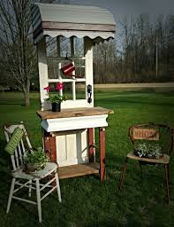 gifts and home decor chair planter and old metal awning and old door potting table all