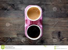 coffee take away coffee cups with covers on wooden table backound