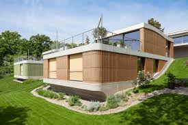 Shape Of House by Curved Shape Of The Roof Connects The Two Floors And Turns The