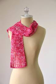 a red lace scarf with one end thrown over the shoulder of a