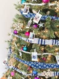 decorating a colorful eclectic family photo christmas tree