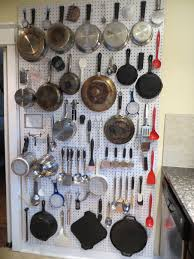 pegboard pan storage or maybe in a utility room dream kitchen
