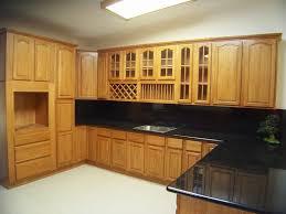 interior in kitchen appliances oak kitchen cabinet with black granite countertops