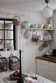 white kitchen butcher block counters open shelving kitchen