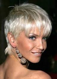 platinum hairstyles for older women woman with very short platinum blonde highlights hair short