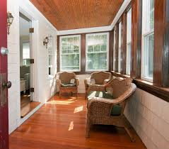 Laminated Wooden Floors Exterior Delightful Glass Enclosed Patio Decor With Brown Wicker