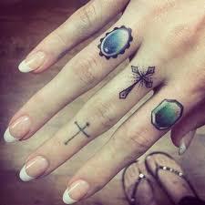 small cross tattoos on finger