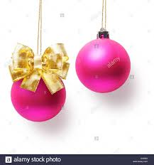 two pink balls decorated with gold bow hanging on ribbon