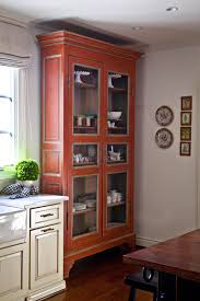 design tip from nell hill u0027s add large free standing cabinets to