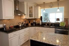 color kitchen cabinets with granite countertops using two granite colors in the kitchen advanced granite