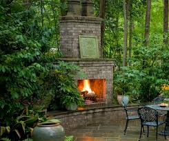 outdoor brick fireplace in the woods outdoor dining slate patio