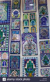 shops in the tunis medina old city display painted ceramic tiles