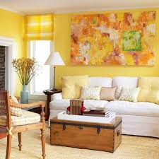 home design with yellow walls living room with abstract wall art and yellow walls also roman