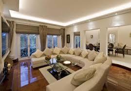 Mocha Laminate Flooring Adorning Interior Design Ideas Showing Many Cream Cushions On