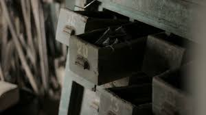 medium shallow depth of field tracking shot revealing old cabinets