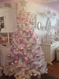white christmas tree with pink decorations