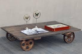 vintage rustic timber door coffee table on industrial wheels