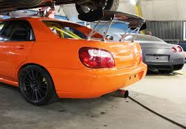 orange subaru impreza tuning subaru impreza wrx sti top level motorsport