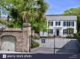 colonial home with privacy fence in historic charleston south