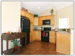 wood floors in the kitchen light wood kitchen cabinets with dark