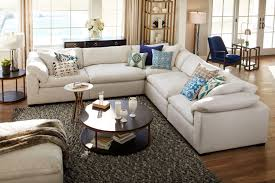 The Plush Sectional Collection Anders Ivory Value City Furniture - Value city furniture living room sets