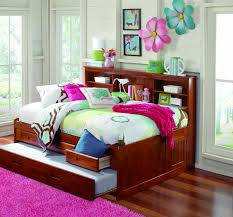 white wooden daybed with three storages and white bed sheet