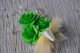 wooden flowers pin on corsage made of wooden flowers green accentsandpetals