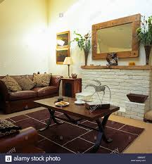 dark wood coffee table and brown leather sofa in economy style
