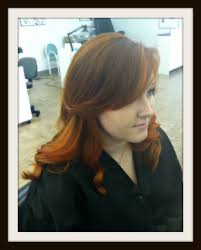 layered haircut with side swept bang haircolor is goldwell elumen