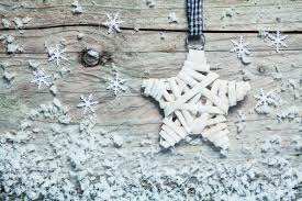 country style christmas star wound with white tape hanging on