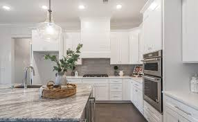 white kitchen cabinets with gray quartz counters quartz vs granite which is best all about countertops