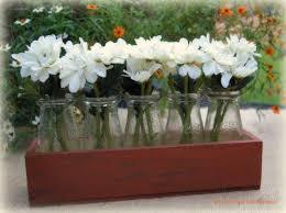 Milk Vases For Centerpieces by Best 25 Milk Bottle Centerpiece Ideas On Pinterest Starbucks