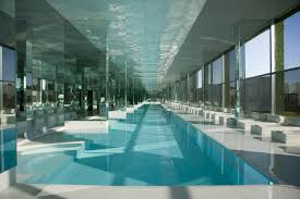 white wall paint with large blue water pool and white waterspout