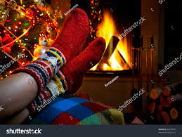 romantic winter evening by fireplace christmas stock photo