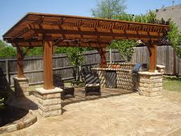 backyard kitchen ideas outdoor kitchen designs with wooden pergola and brown chairs 266