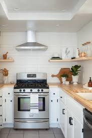 kitchen design white cabinets black appliances make a small kitchen look larger with these clever design