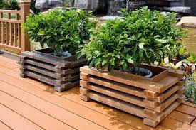 raised flower bed in wooden box ideas with flower pots planters