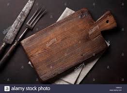 old vintage kitchen utensils fork knife cutting board top view
