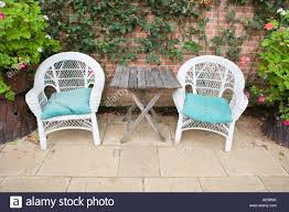 Outdoor Garden Chairs Uk Two White Cane Garden Chairs Uk In Summerhouse Stock Photo