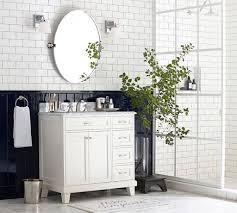 oval pivot bathroom mirror white brick wall backsplash and oval pivot mirrors using black lower