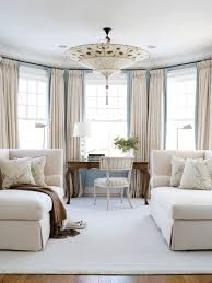 with its pale blue walls and plush cream wool chaises lovely