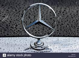 logo mercedes mercedes benz star logo on an rainy hood stock photo royalty free