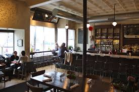 table for four at lula cafe domain realty