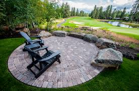 broken top entertainment patio and new lawn leading to the golf