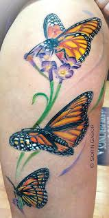 color monarch butterfly on thigh by sorin gabor