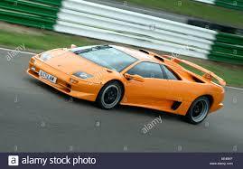 lamborghini murcielago racing lamborghini murcielago sports car on a race track stock photo