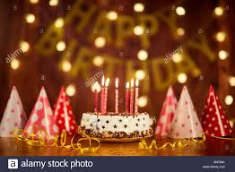 birthday cake candles happy birthday cake with candles on the background of garlands a