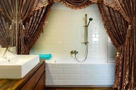 How To Hang Curtain Swags by Decorating With Double Swag Shower Curtains Lovetoknow