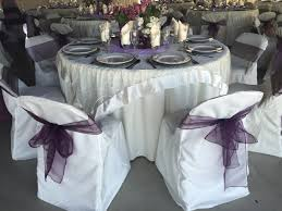 chair bows ivory table cloth with ivory organza overlay accented with plumb