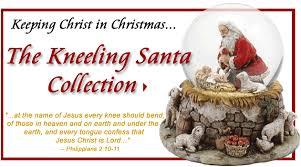 santa kneeling at the manger kneeling santa christmas cards email october 24 2006